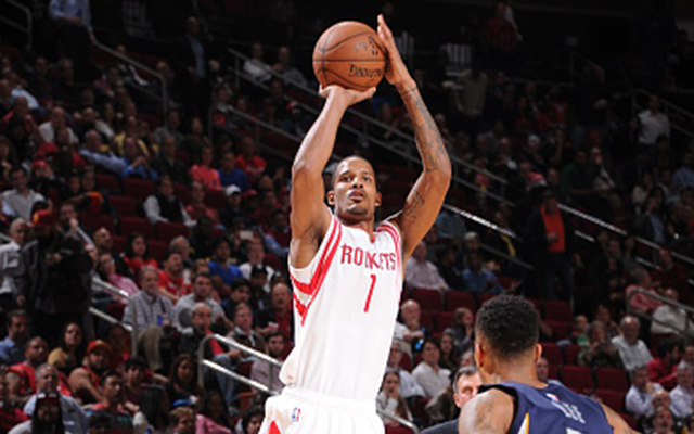 HOUSTON, TX -  DECEMBER 3: Trevor Ariza #1 of the Houston Rockets takes a shot against the Memphis Grizzlies on December 3, 2014 at Toyota Center in Houston, Texas. NOTE TO USER: User expressly acknowledges and agrees that, by downloading and or using this Photograph, user is consenting to the terms and conditions of the Getty Images License Agreement. Mandatory Copyright Notice: Copyright 2014 NBAE (Photo by Bill Baptist/NBAE via Getty Images)